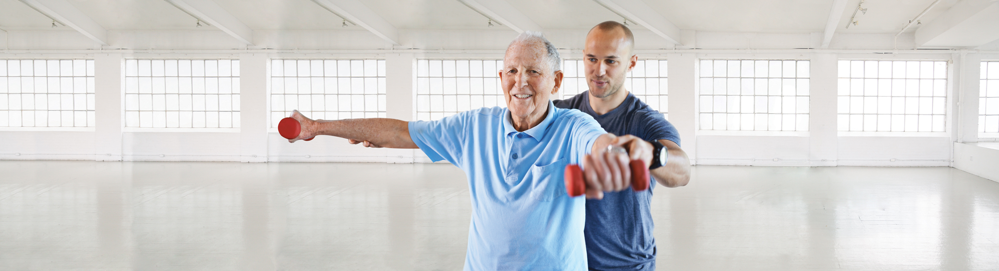 man helping senior work out
